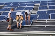 Photo of workers installing the panels